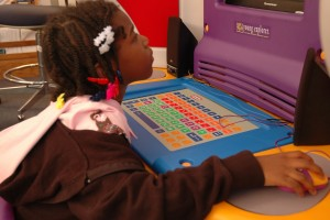 "India Cotton, 5, uses one of the ""Young Explorer"" children's computers at the Martin Luther King Jr. Reading and Cultural Center on November 11, 2009. When asked what she liked best about coming to the center--a former branch of the Carnegie Library--Cotton replied ""I like books and playing."" By Andrew Weier, Point Park News Service."